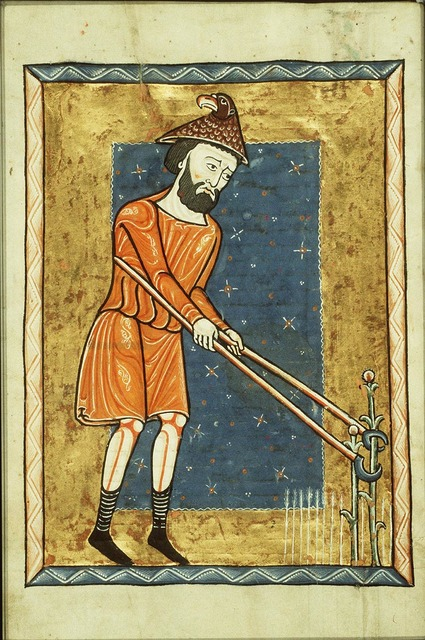 July: a man weeding