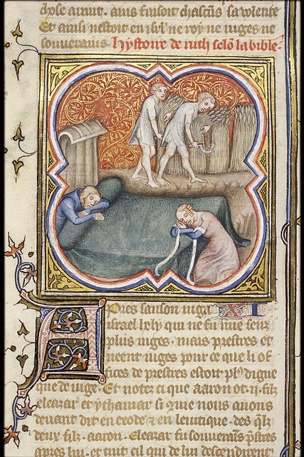 Boaz is asleep; Ruth, having uncovered his feet, lies down; two men mowing (background)