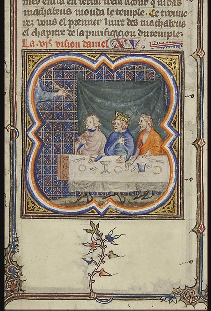 During Belshazzar's banquet a hand appears and writes on the wall (MENE, MENE, TEKEL and PARSIN (UPHARSIN))