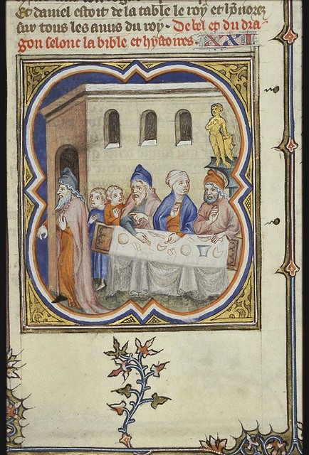 The priests of Bel, with their wives and children, enter the temple through a hidden corridor and feast on the food during the night