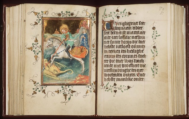 St. George on horseback fighting the dragon, stabbing it with his lance; the princess nearby, praying