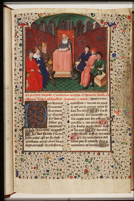 A lecturer reading from St. Thomas Aquinas' Information des Princes to an emperor, a king, a chancellor and three noblemen