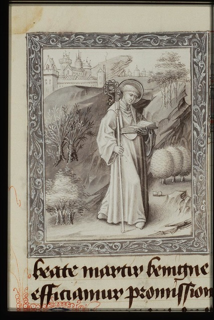 St. Benignus holding a staff and a book