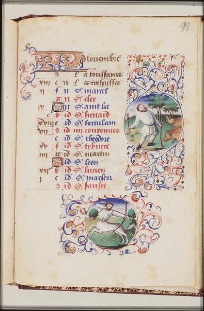 November: a man knocking acorns out of oak-trees