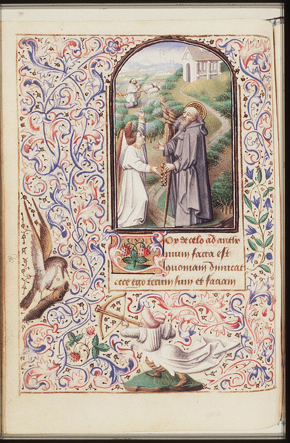 St. Antony Abbot of Egypt holding a rosary and a staff, with an angel
