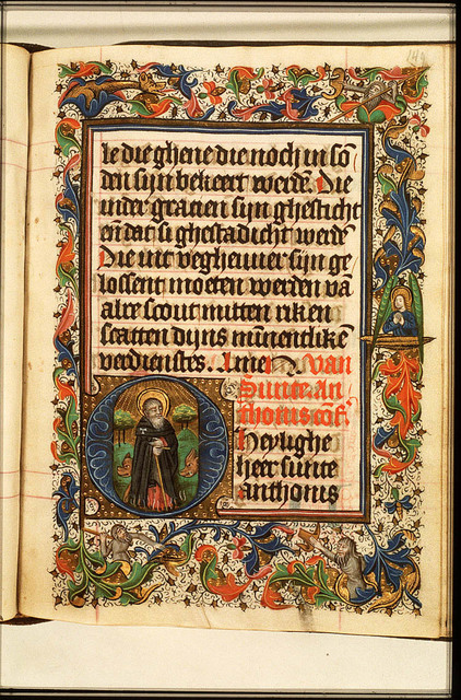 St. Antony Abbot of Egypt standing on flames and holding a staff, with two pigs