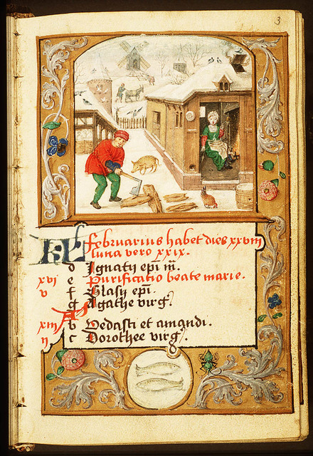 February: a man chopping wood, a woman warming herself at a fire
