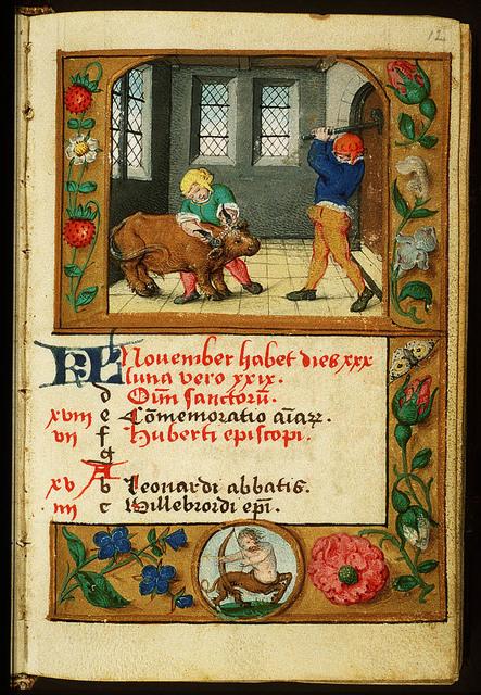 November: two men slaughtering a bull