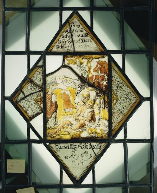 """Ruit met de barmhartige Samaritaan die de gewonden helpt met onderschrift """"Corneilus van Hoeff Ao 1609"""""""