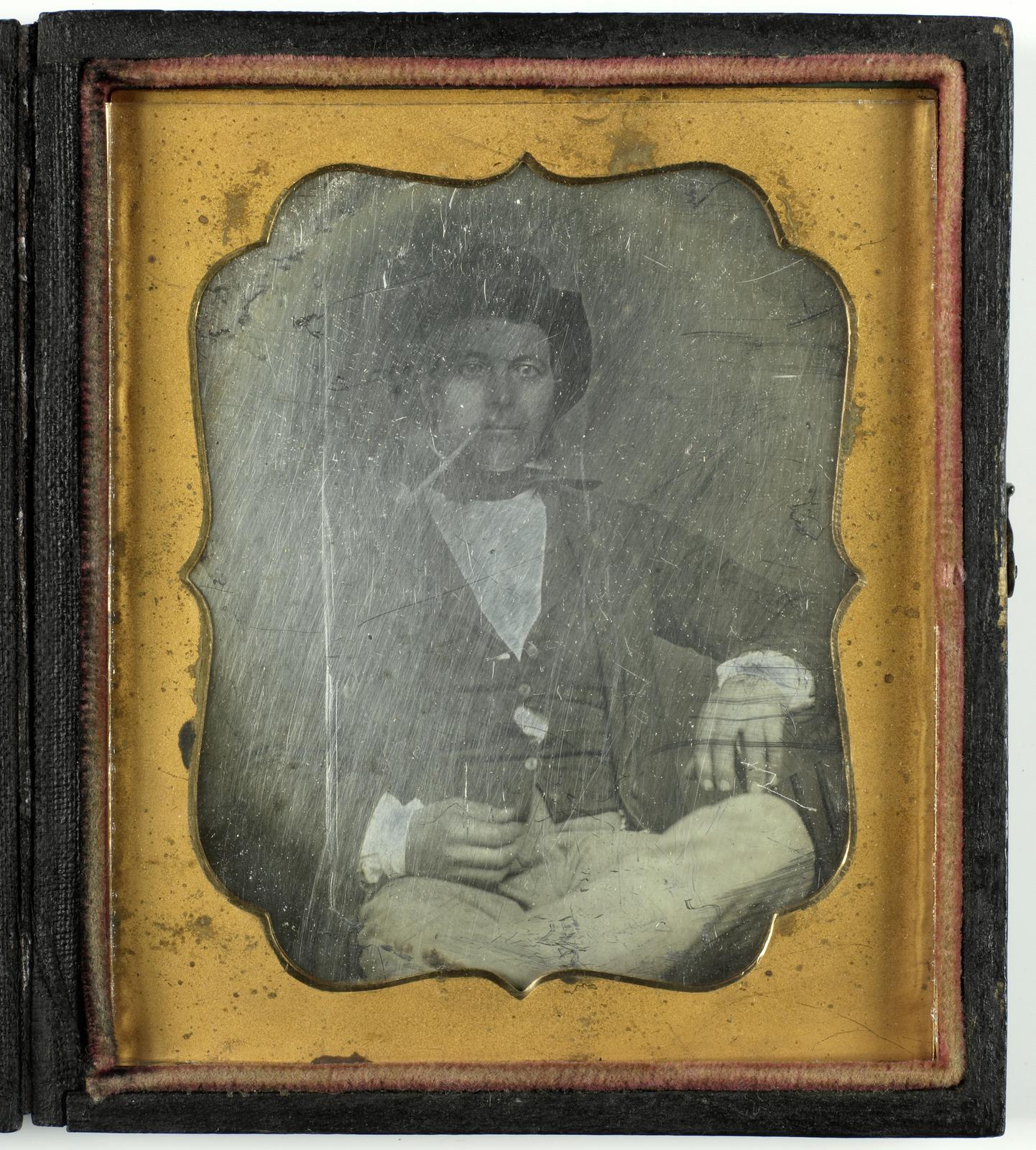 Portret van een man met hoed en pijp