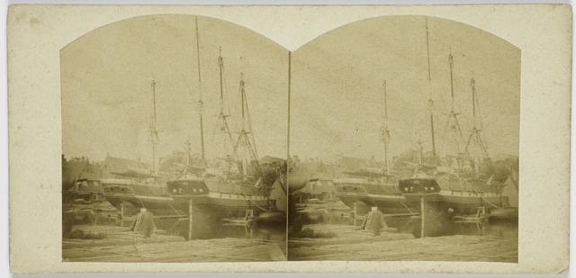 Eene werf met schepen te Amsterdam