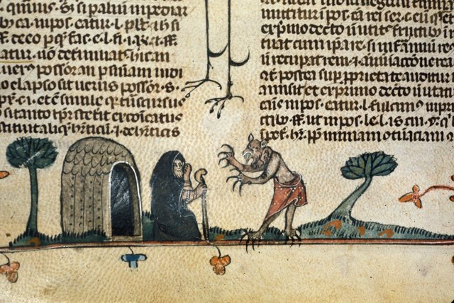 Devil and hermit from BL Royal 10 E IV, f. 113v
