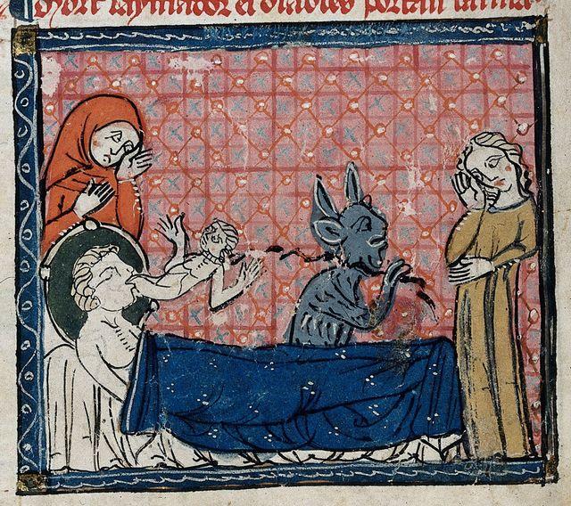 Devil carrying off a lover's soul from BL Royal 19 C I, f. 204v
