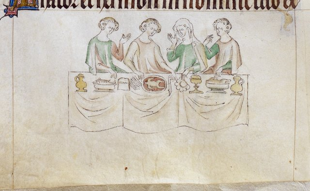 Four at table from BL Royal 2 B VII, f. 199v