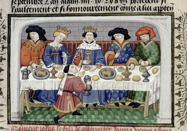 Iobas offering poisoned wine to the feasting Alexander from BL Royal 15 E VI, f. 22v