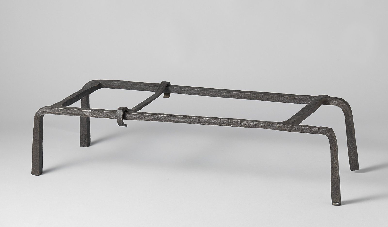 Andiron with cooking pots and a pair of fire tongs