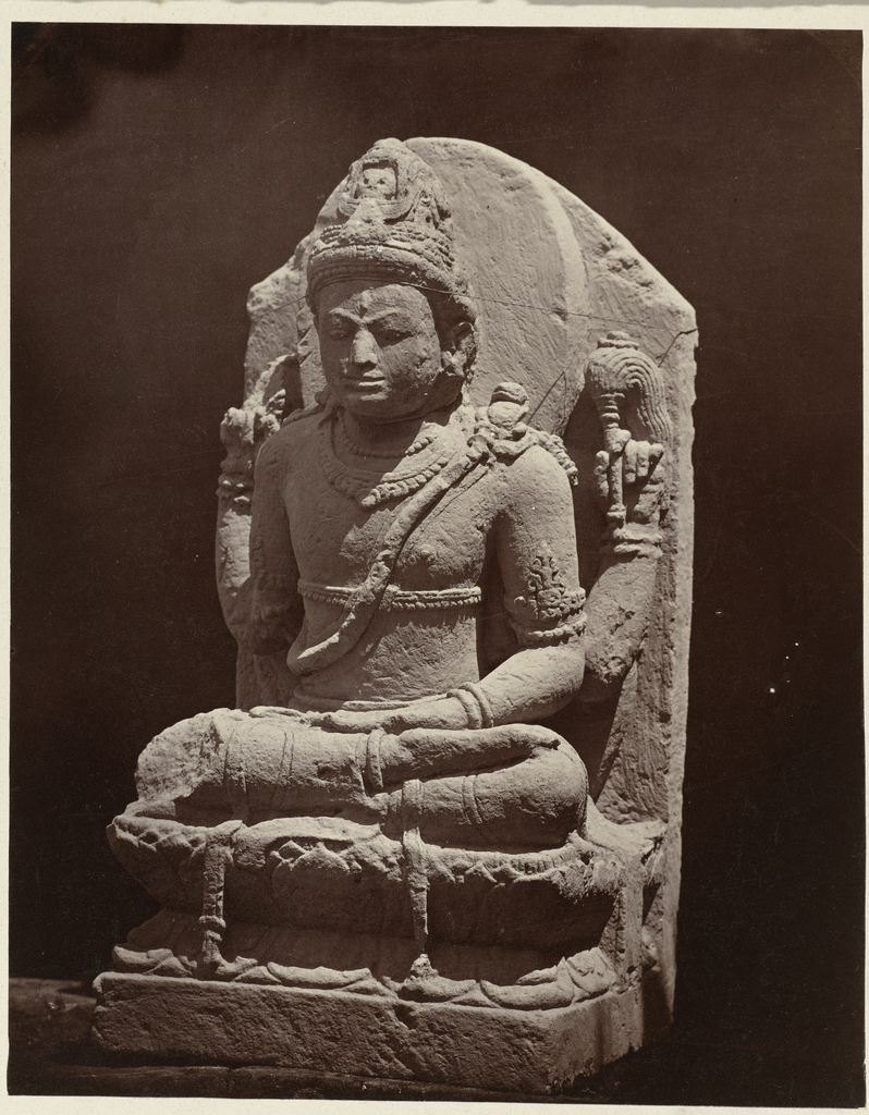 Four armed Shiva of which one arm, probably displaying the varada mudra, has broken off. Dieng Plateau, Wonosobo district, Central Java province, 9th century.