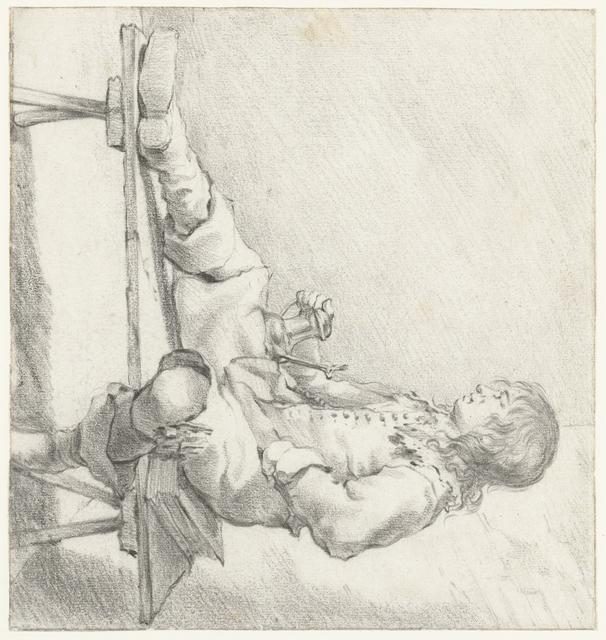 Jonge man op een bankje, zittend op een boek