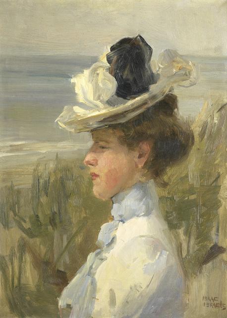 Jonge vrouw, uitkijkend over zee