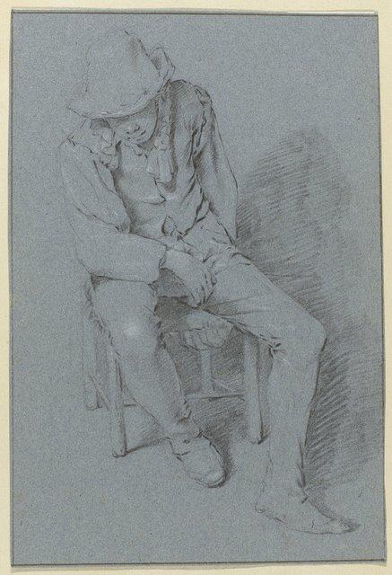 Jongeman met hoed zittend op een stoel of kruk