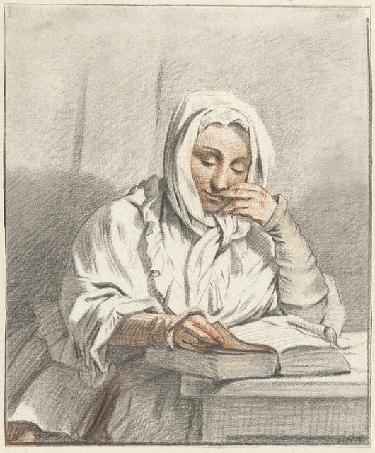 Lezende jonge vrouw aan een tafel