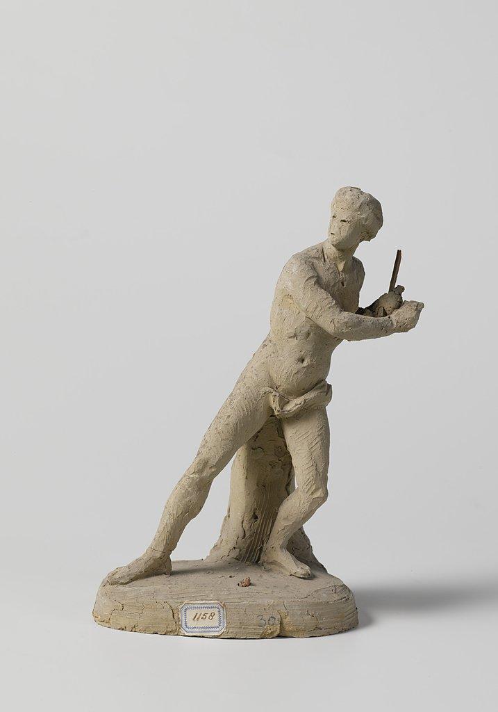 Naakte jongeling bezig met een ringspel