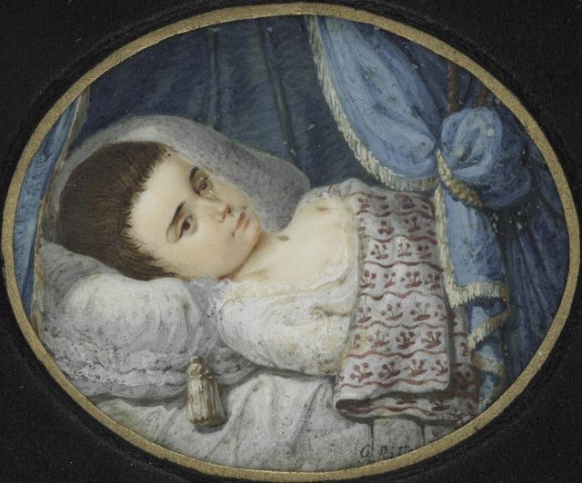 Portret van een ziek meisje in bed liggend