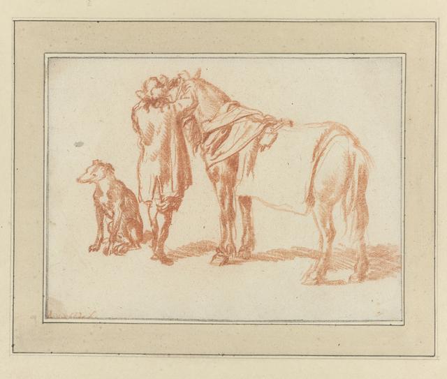 Ruiter naast een paard en een hond
