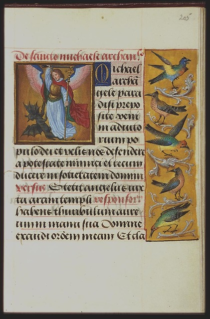 St. Michael holding a sword and a cross-staff fighting the devil