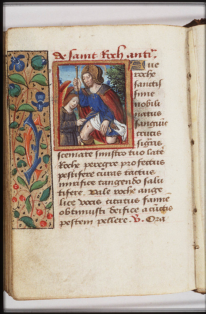 St. Roch of Montpellier holding a staff, with a dog with a loaf in its mouth, and an angel healing the plague-spot inside his thigh