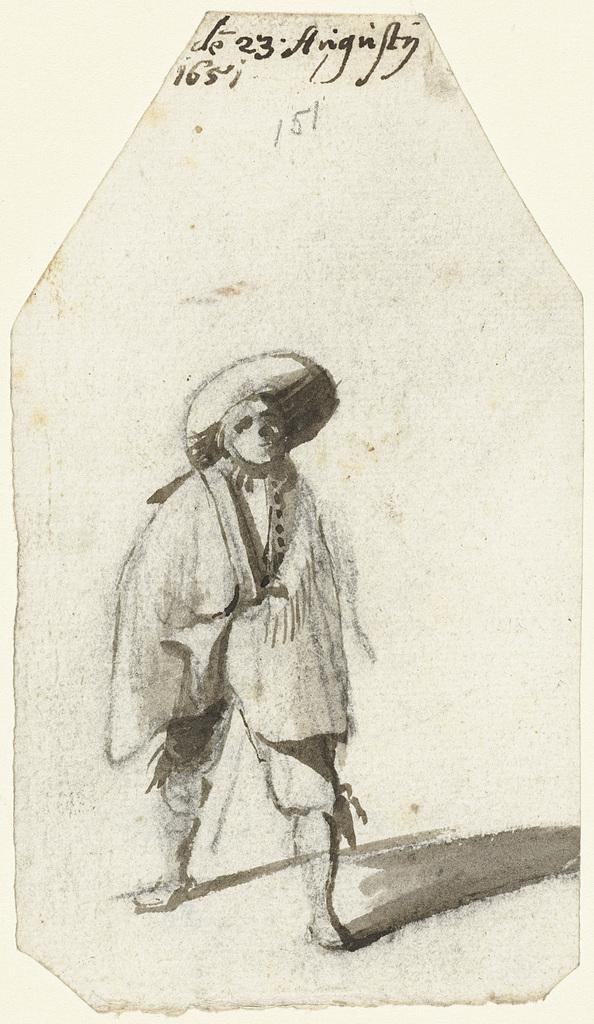 Staande jongeman met een breedgerande hoed en een mantel