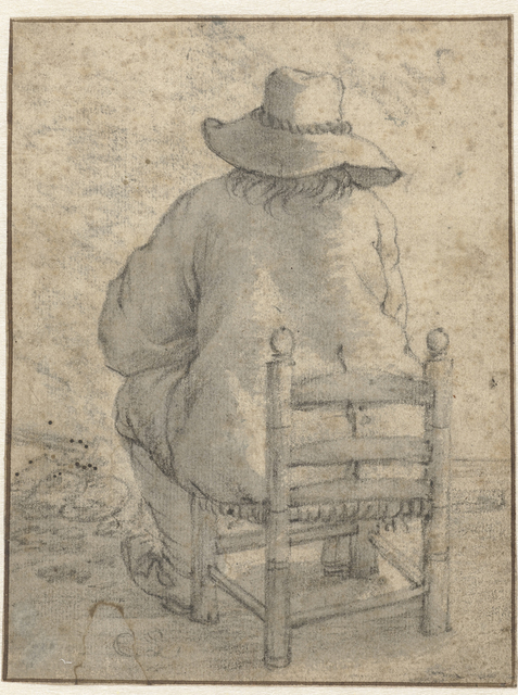 Zittende jongen met hoed, van achteren