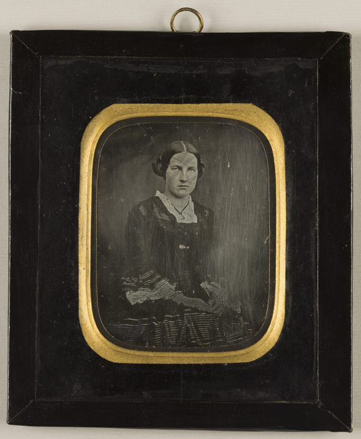 Portrait of a woman seated