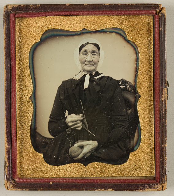 Portrait of an elderly woman, knitting