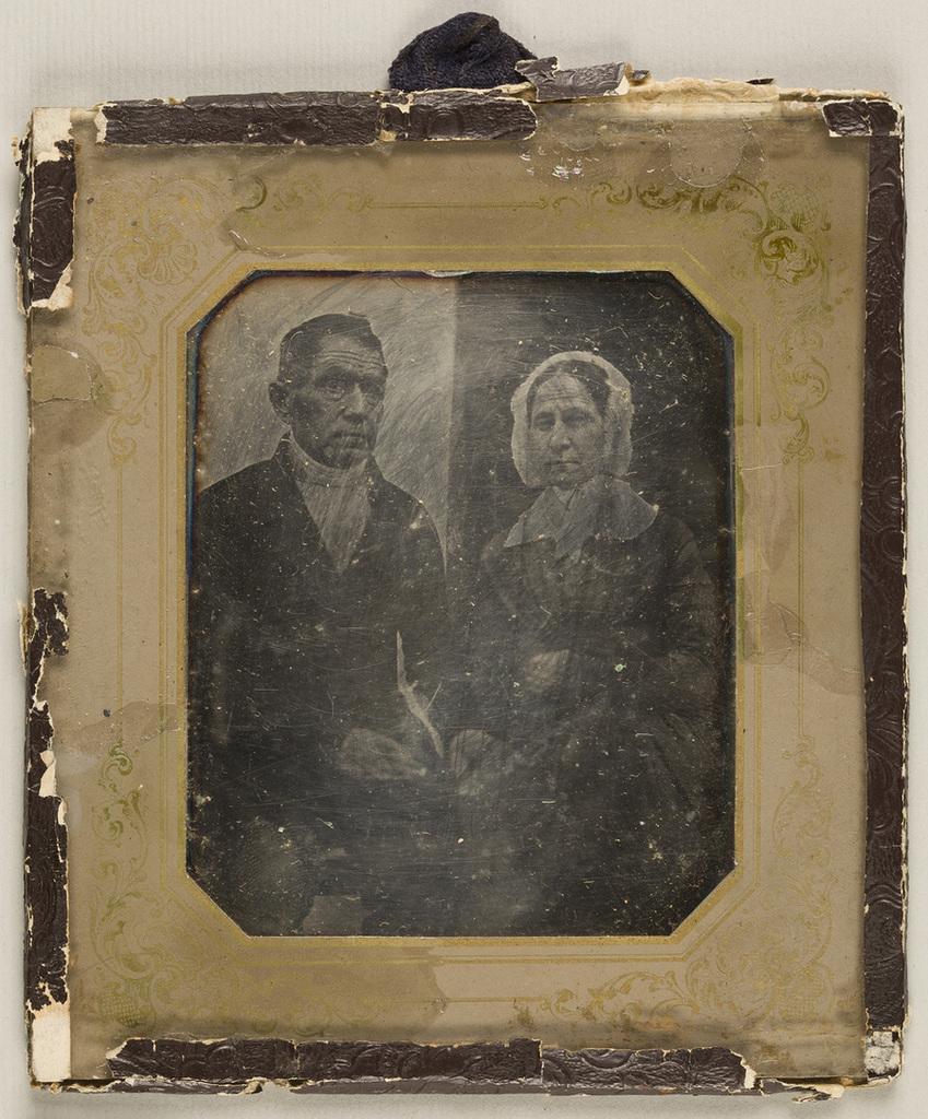 Portrait of elderly couple. Backgroud is devided in two - dark and light halves