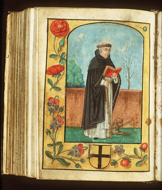 St. Dominic of Calerueja holding a book and a staff, a dog at his feet with a quill in its mouth
